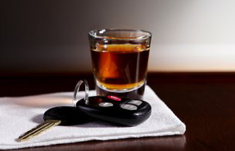 Car keys and shot glass